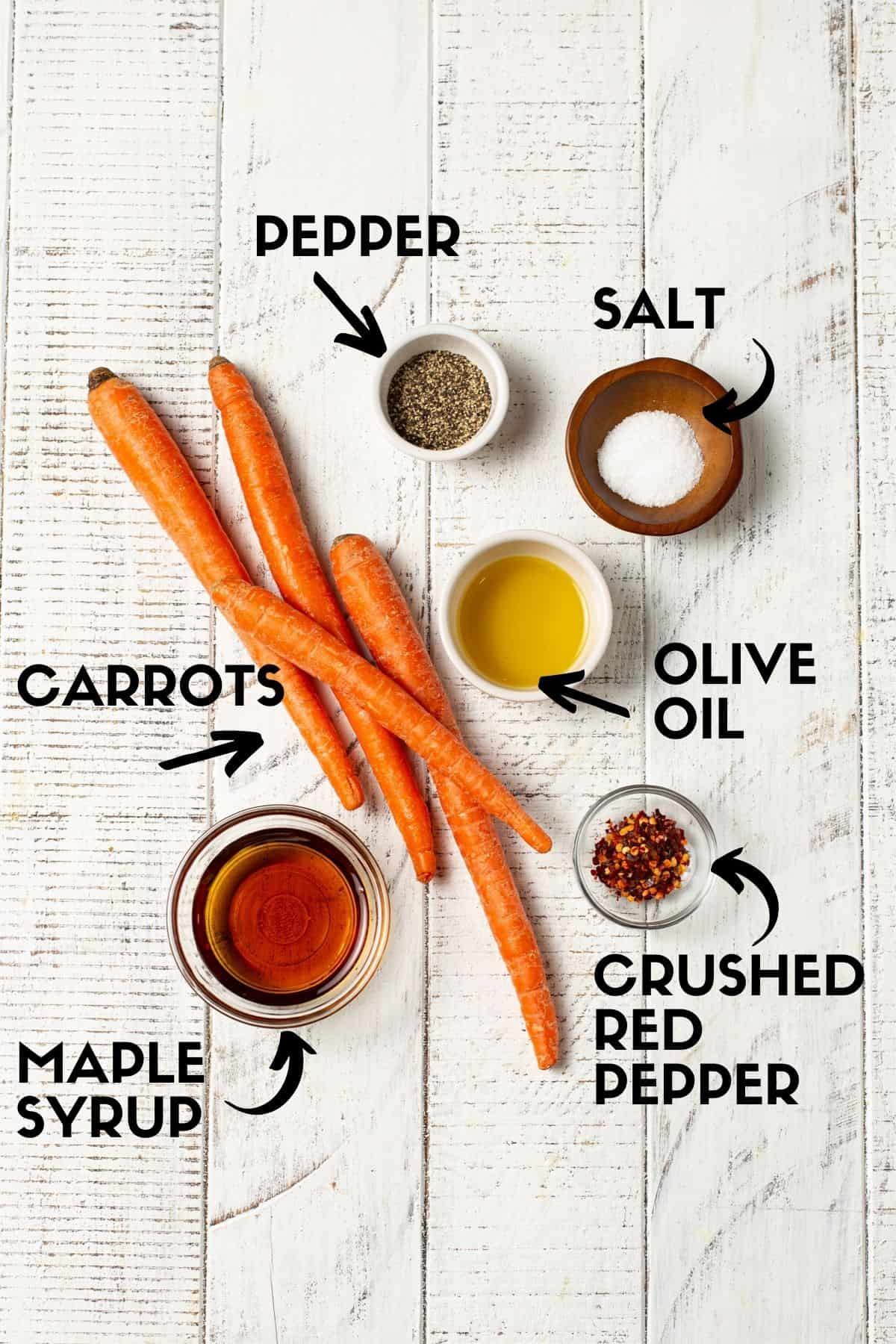 Ingredients needed for roasted carrots, including carrots, maple syrup and crushed red pepper.