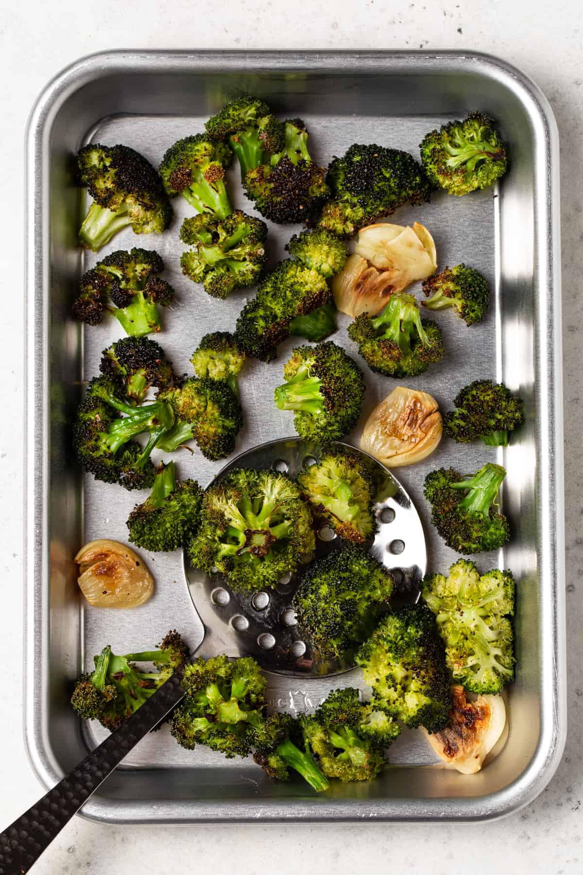 Roasted broccoli on a sheet pan.