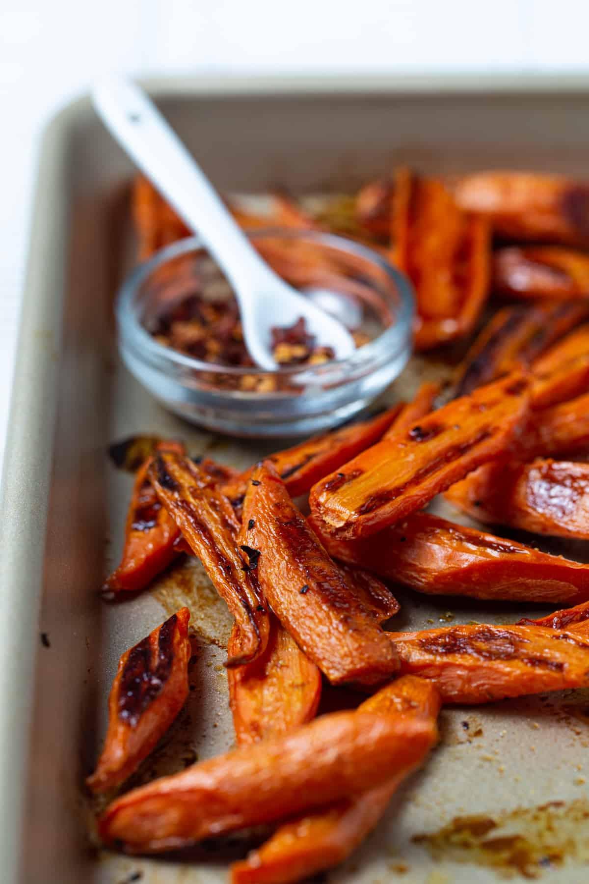 Roasted carrots on a sheet pan.