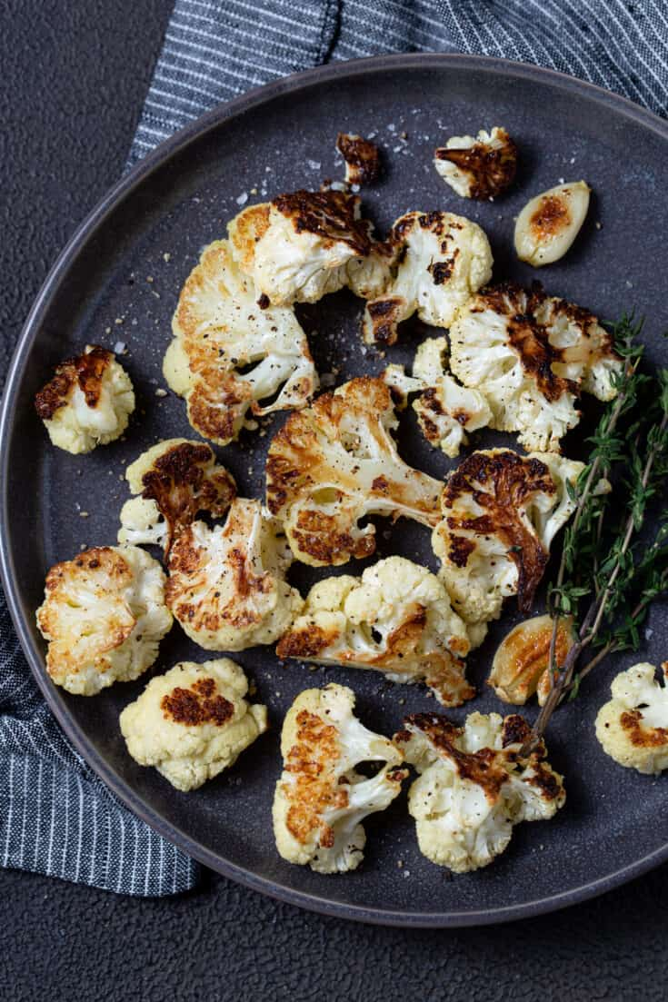 cauliflower on plate with fresh thyme.