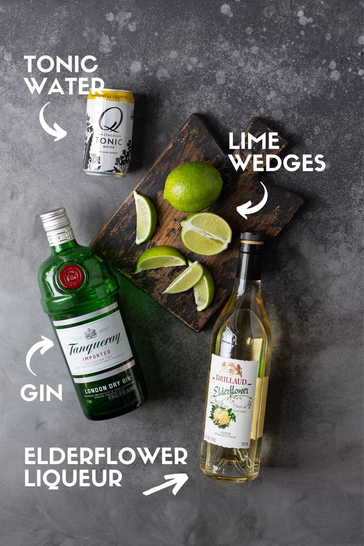 Ingredients for elderflower gin and tonic including gin, tonic water and elderflower liqueur.