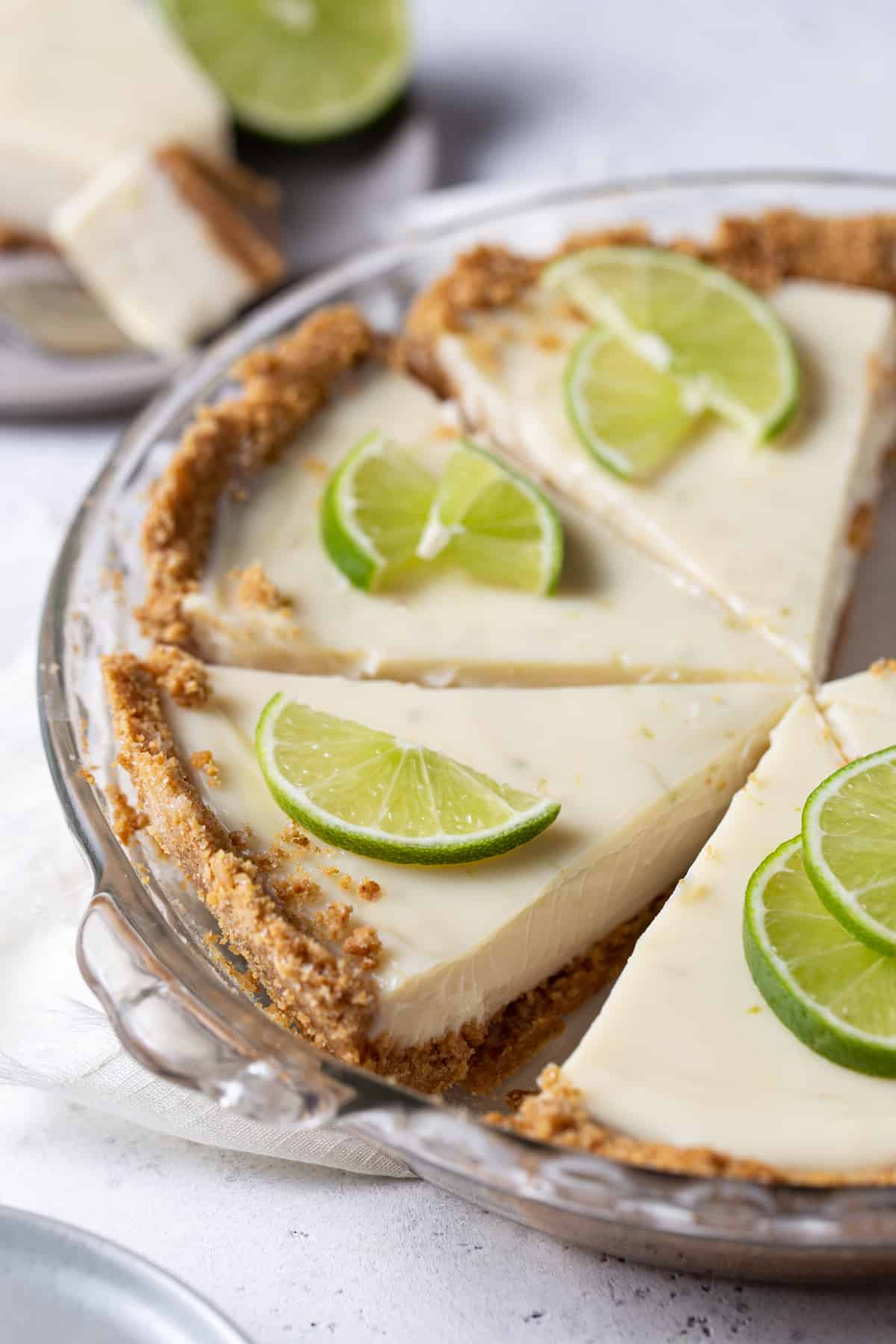 slices of pie in baking dish with lemon wheels.