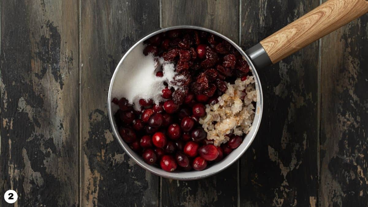 Ingredients for cranberry sauce in a pot.