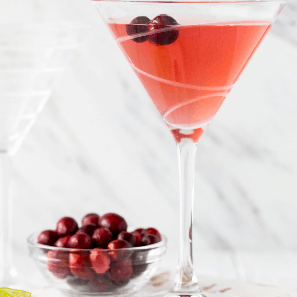 martini glass filled with pink drink.