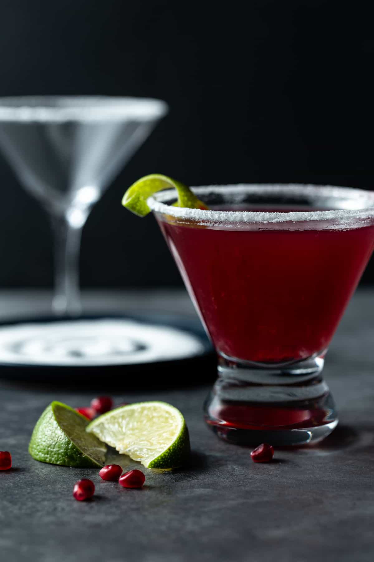 A glass filled with pomegranate martini.