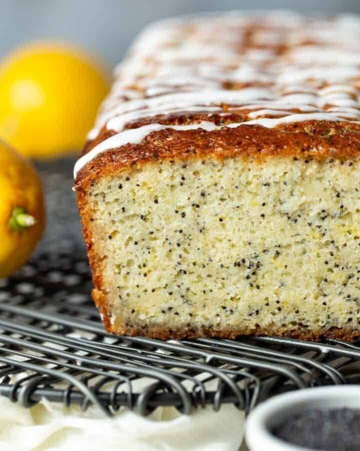 Lemon poppy seed bread loaf on a wire platter.