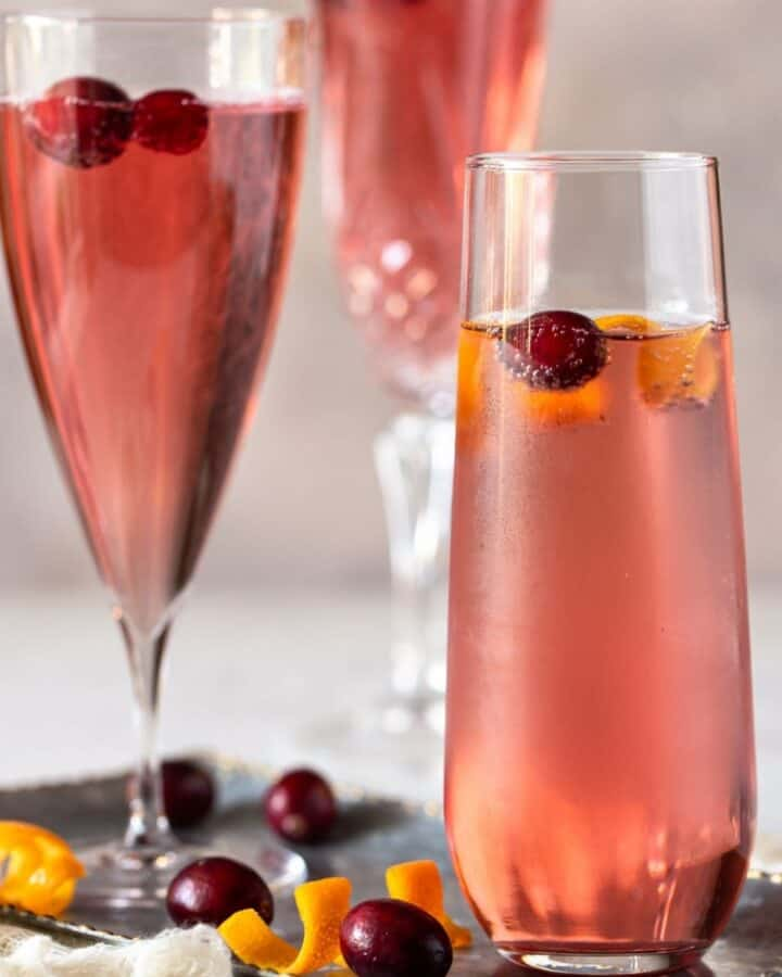 champagne flutes filled with cranberry juice and prosecco.