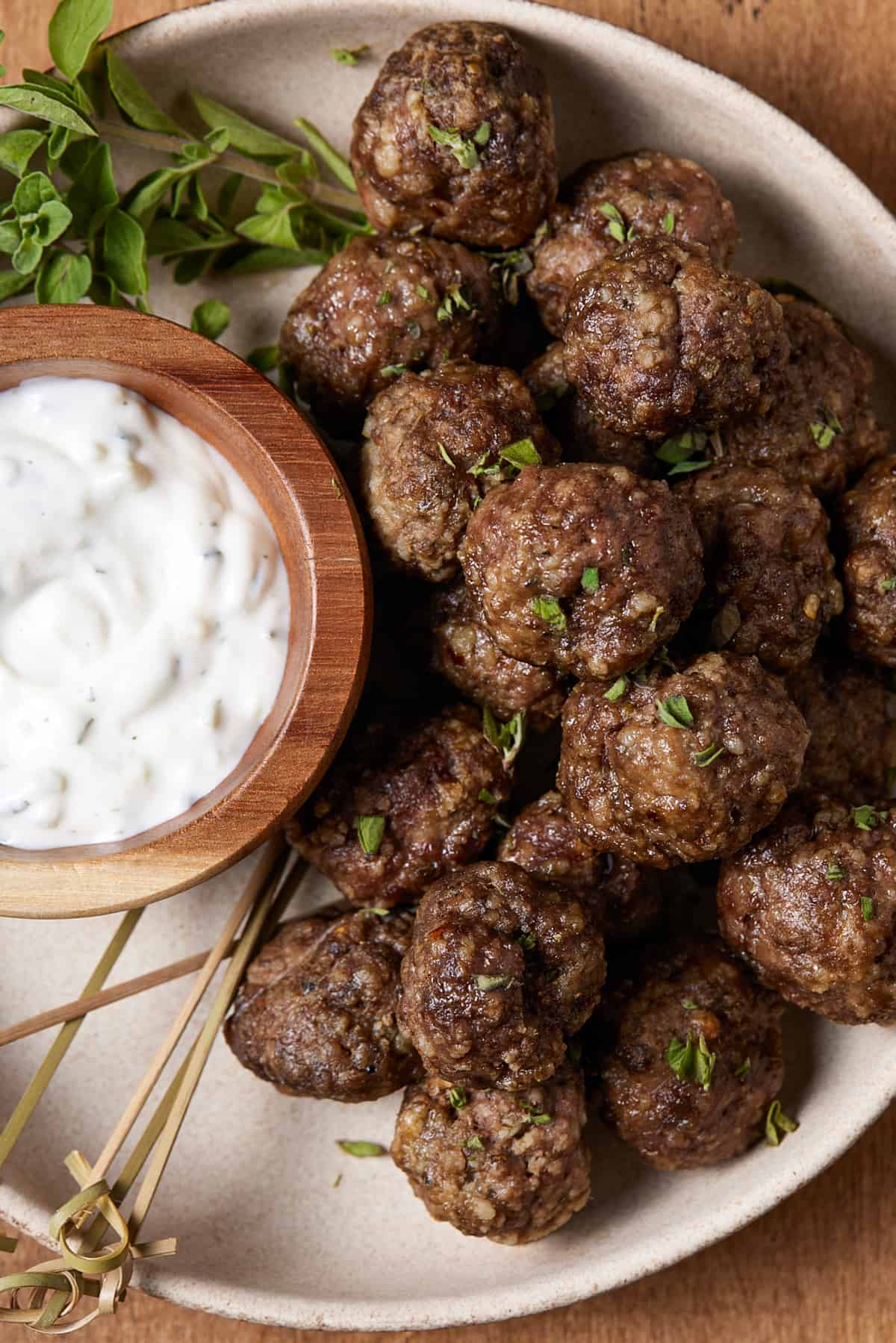 meatballs on a plate with dipping sauce.
