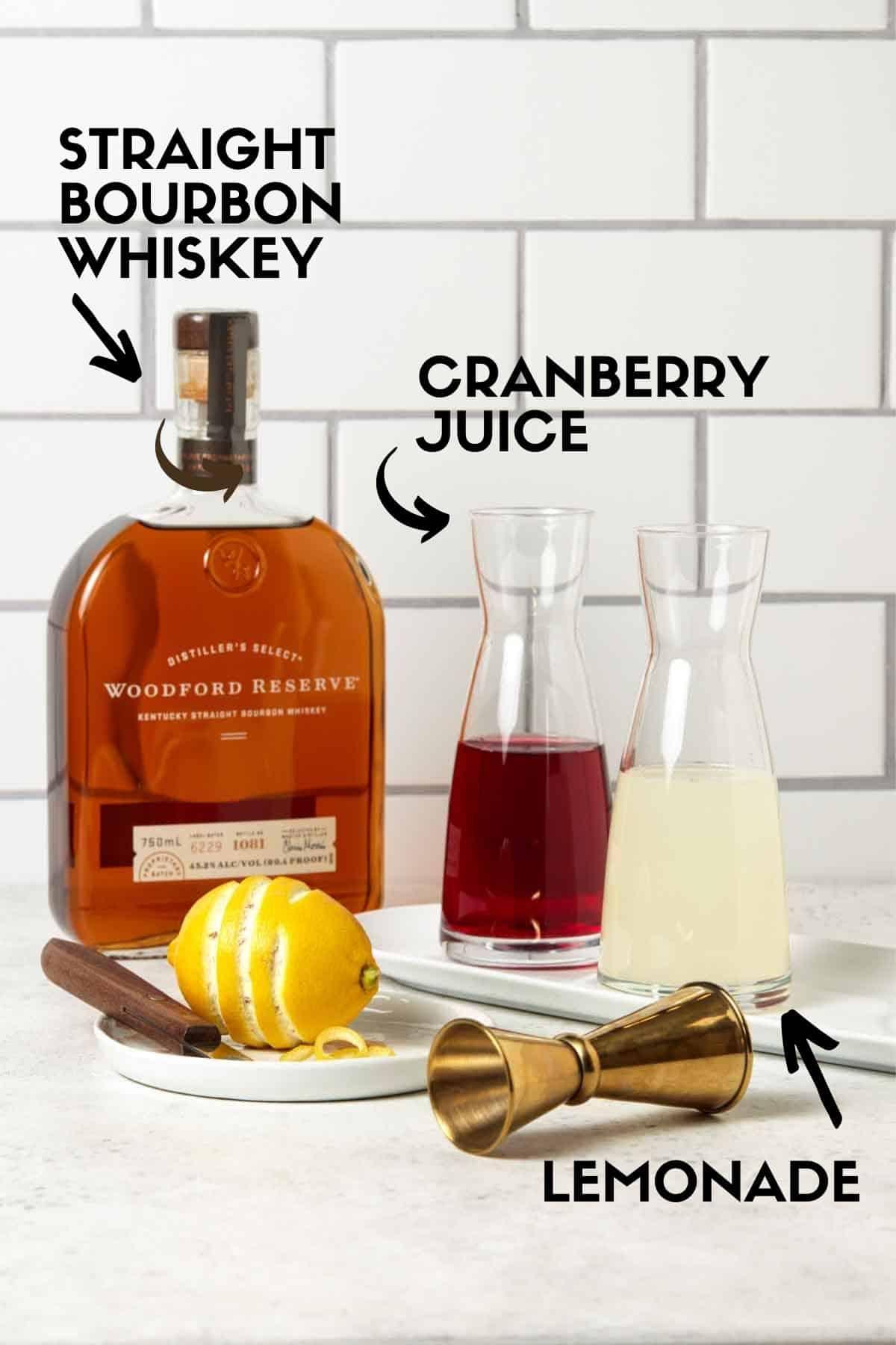 Ingredients for Woodford Spire Cocktail, including bourbon, lemonade & cranberry juice.