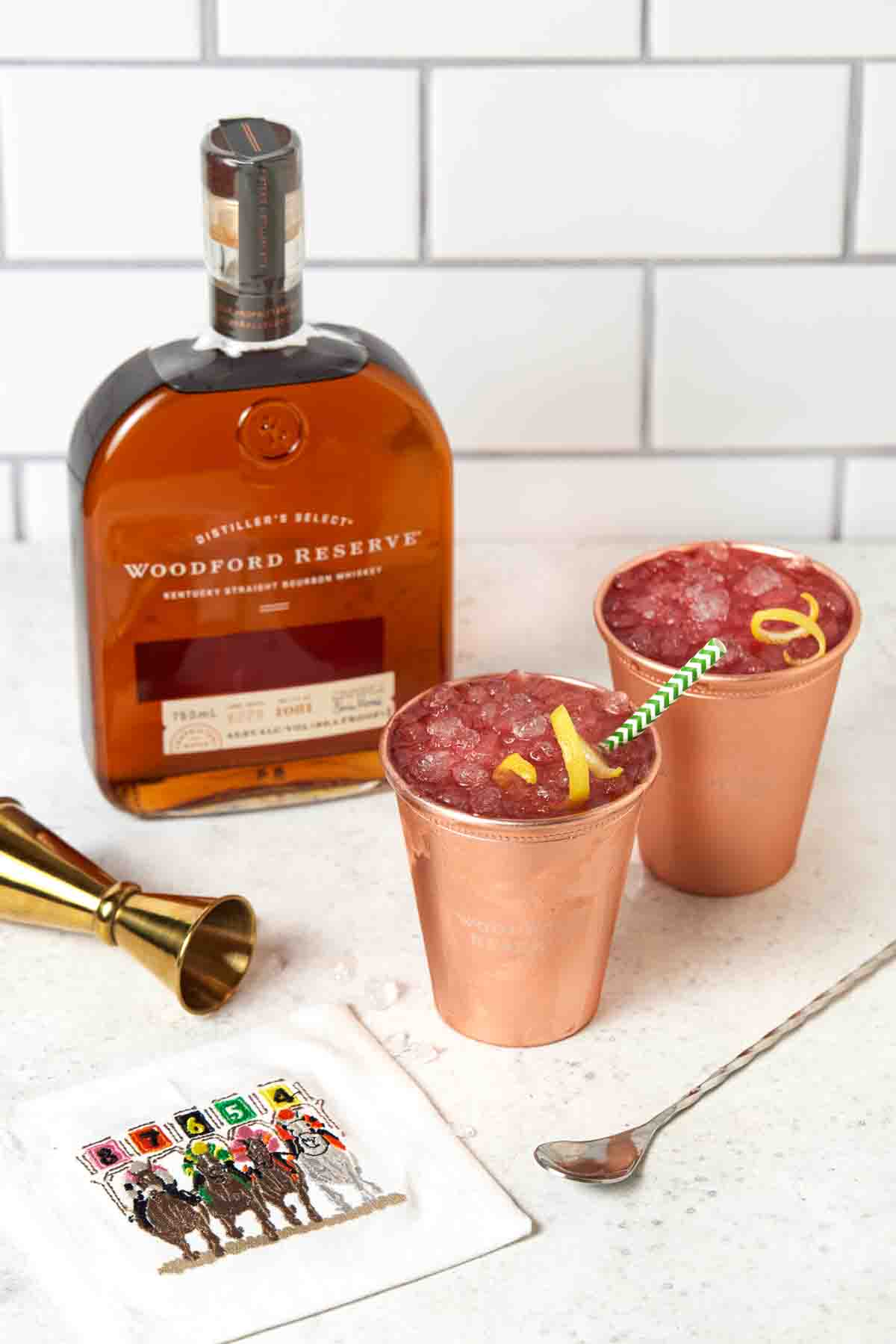 Two copper cups filled with Woodford Spire Cocktails.