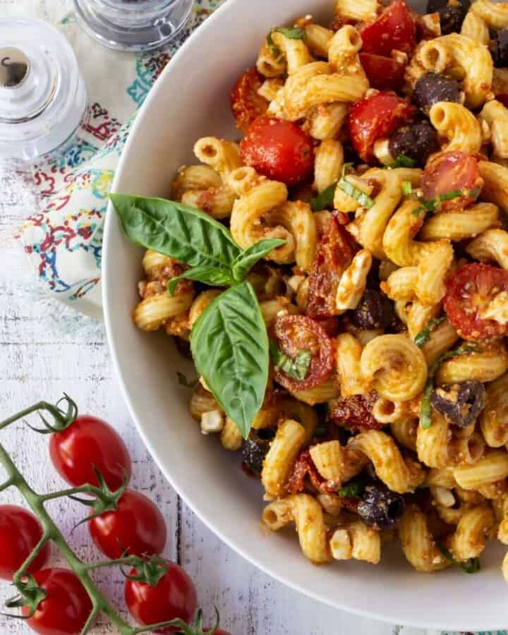 tomatoes, feta and pasta in bowl.