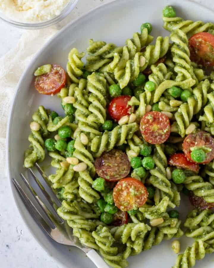 pesto pasta on plate.