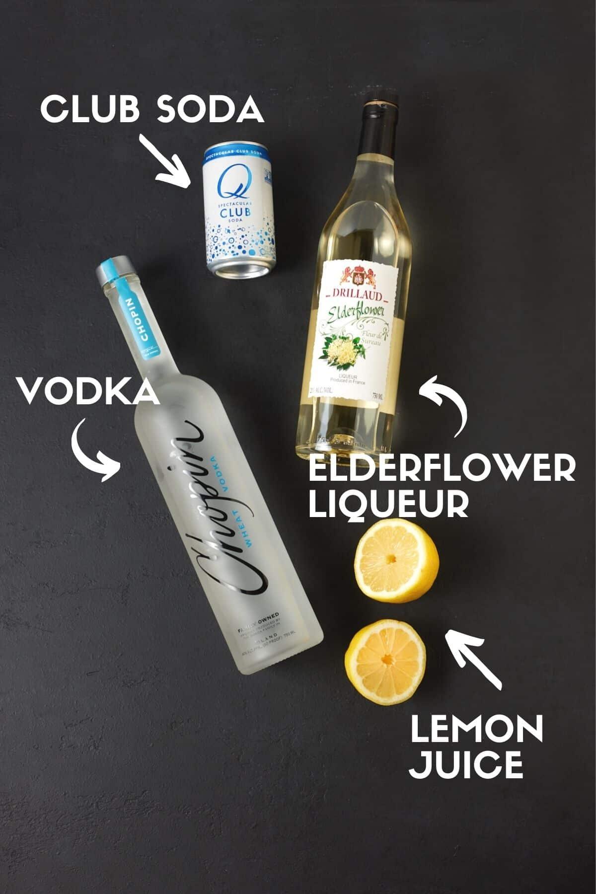 Ingredients for Elderflower Vodka Soda drink, including vodka, club soda and lemon juice.