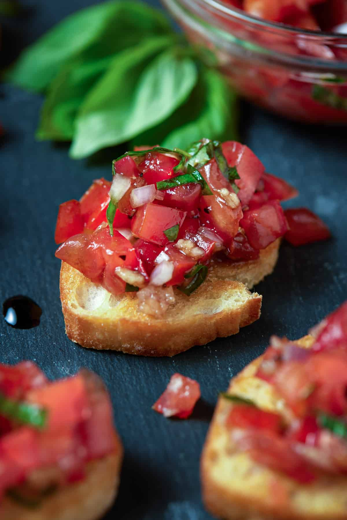 diced tomatoes on crostini with balsamic glaze.