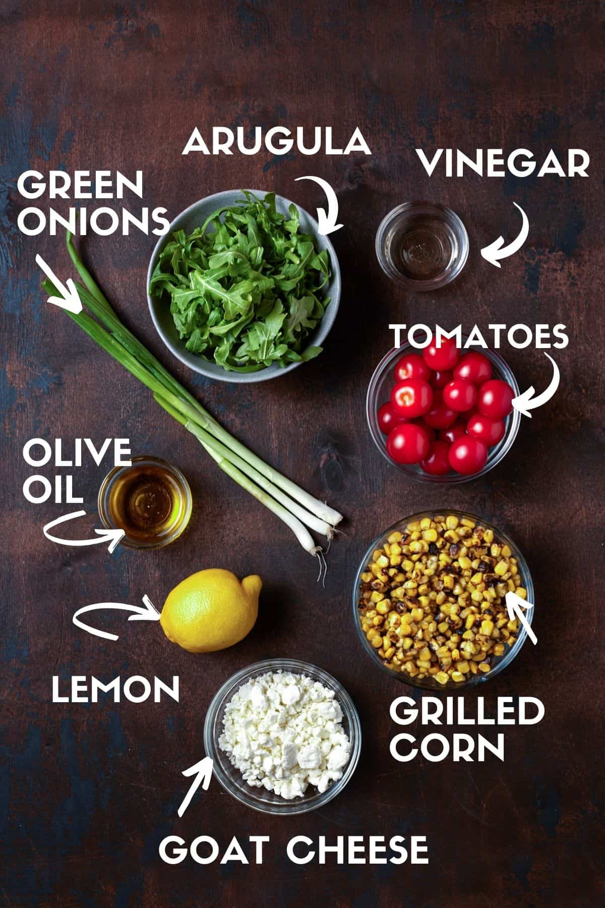Ingredients for arugula, corn and goat cheese salad.