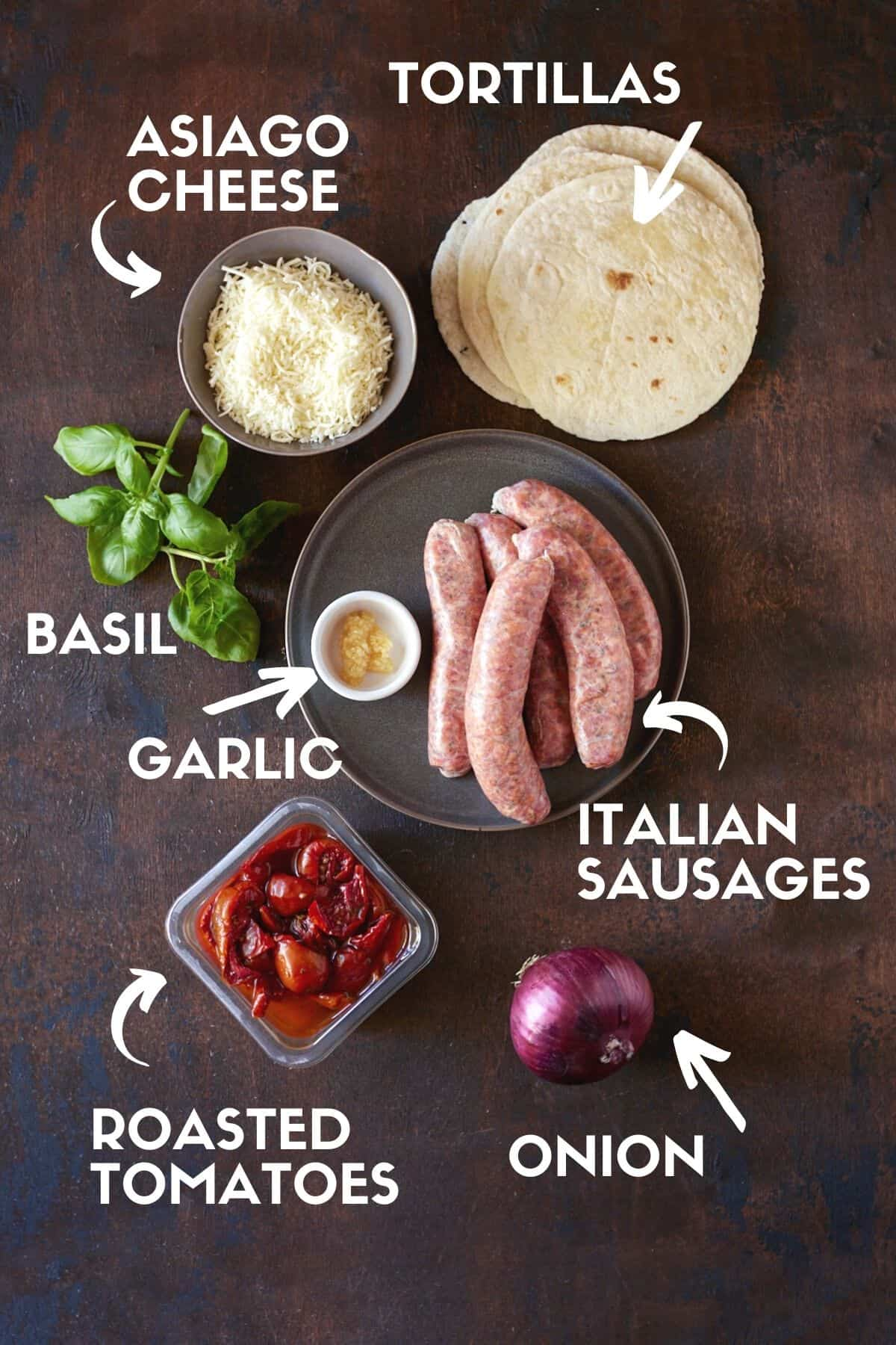 Ingredients for Italian Grilled Sausages, including sausages, roasted tomatoes and tortillas.