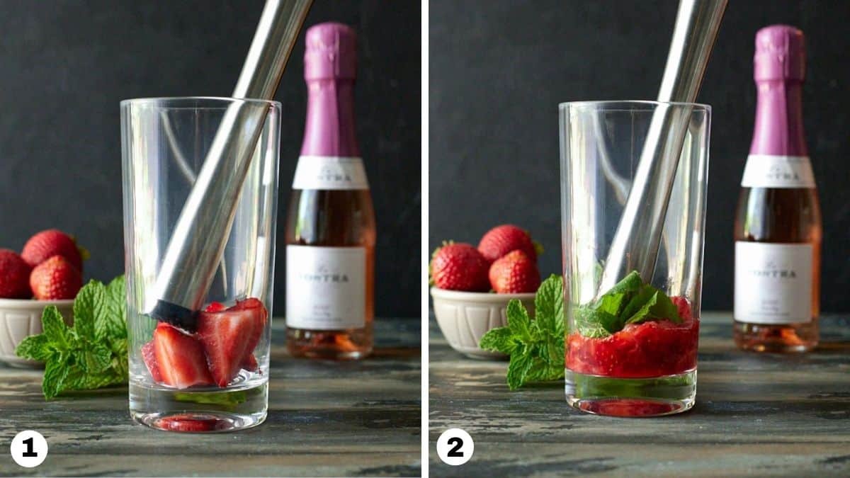 Strawberries and mint in a highball glass with a muddler.