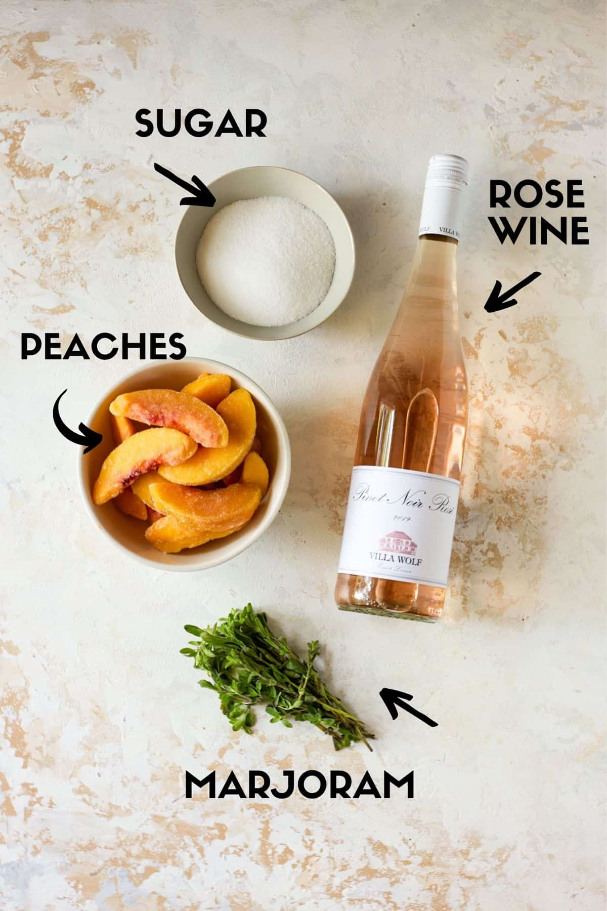 Ingredients for Peach Frosé recipe, including Rosé wine, peaches, sugar and marjoram.