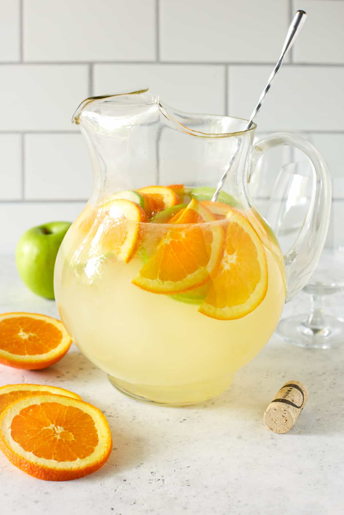 pitcher filled with lemonade and fresh fruit slices.