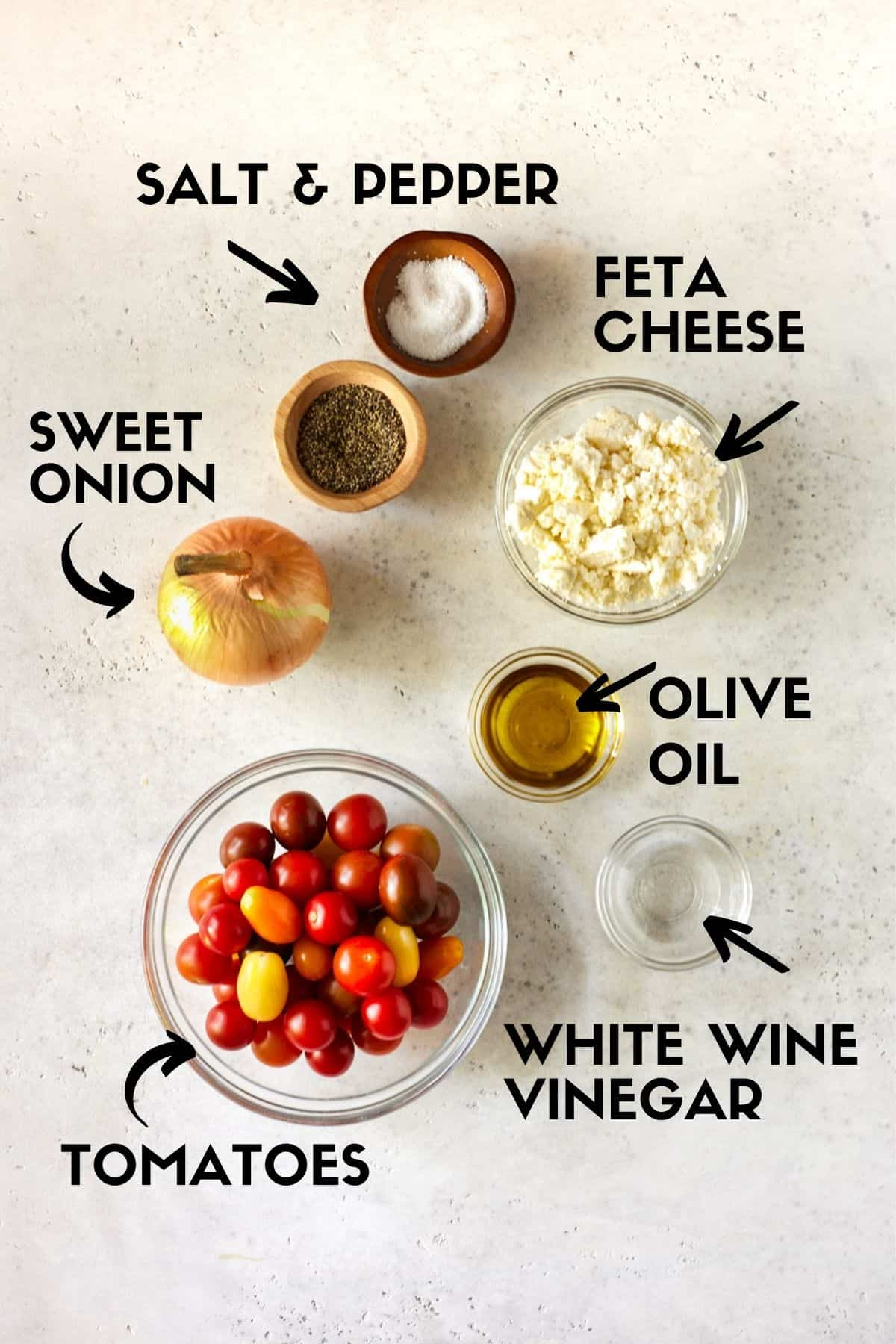Ingredients for Cherry Tomato Salad including tomatoes, onion, feta cheese and vinegar.