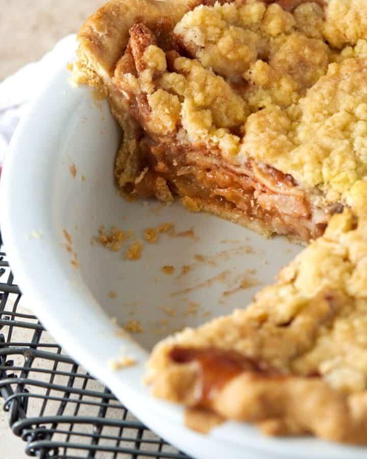 apple crumble pie in white baking dish.