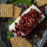 cranberry salsa and cream cheese on plate.