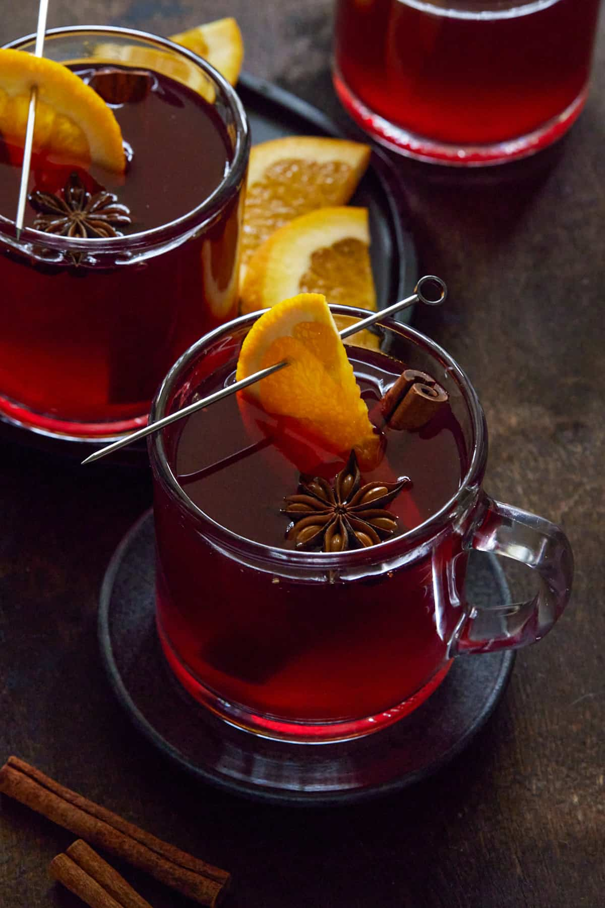 Glass mugs filled with non-alcoholic mulled wine.